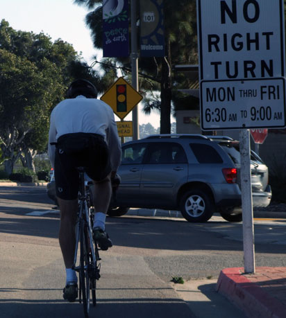 bicyclists riding in bike lane in Solana Beach in front of attorney Dean Goetz's law office